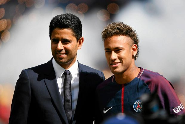 Brazilian soccer star Neymar poses with PSG president Nasser Ghanim Al-Khela??fi at the Parc des Princes stadium in Paris, Saturday, Aug. 5, 2017, during his official presentation to fans ahead of Paris Saint-Germain's season opening match against Amiens. Neymar would not play in the club's season opener as the French football league did not receive the player's international transfer certificate before Friday's night deadline. The Brazil star became the most expensive player in soccer history after completing his blockbuster transfer from Barcelona for 222 million euros ($262 million) on Thursday. (AP Photo/Francois Mori)