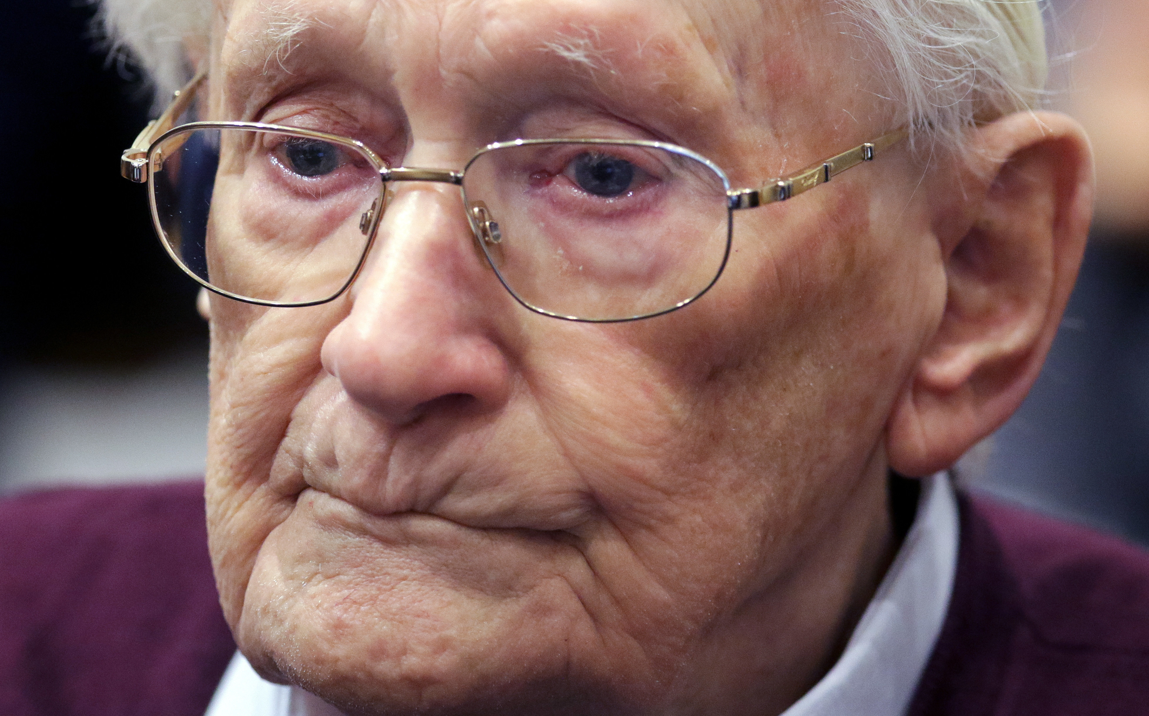 FILE - In this July 15, 2015 file photo SS sergeant Oskar Groening listens to the verdict of his trial at a court in Lueneburg, northern Germany. A German court has rejected the appeal of the former Auschwitz guard against serving his sentence on 300,000 counts of accessory to murder. The Celle state court ruled Wednesday, Nov. 29, 2017, that Oskar Groening was good enough health to serve his four years in prison. (Axel Heimken/Pool Photo via AP, file)