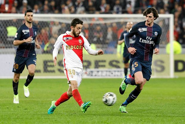Monaco's Bernardo Silva, center, challenges for the ball with PSG's Adrien Rabiot, right, during their League Cup final soccer match in Decines, near Lyon, central France, Saturday, April 1, 2017. (AP Photo/Laurent Cipriani)