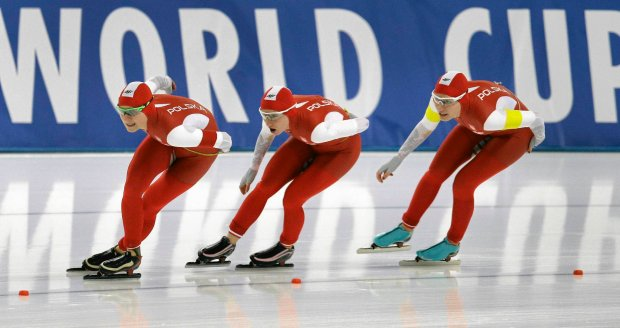 Luiza Zlotkowska, Katarzyna Wozniak and Alekandra Goss from Poland compete during the Women's Team Pursuit race of the speedskating World Cup, in Berlin, Germany, Saturday, Dec. 6, 2014. (AP Photo/Michael Sohn)