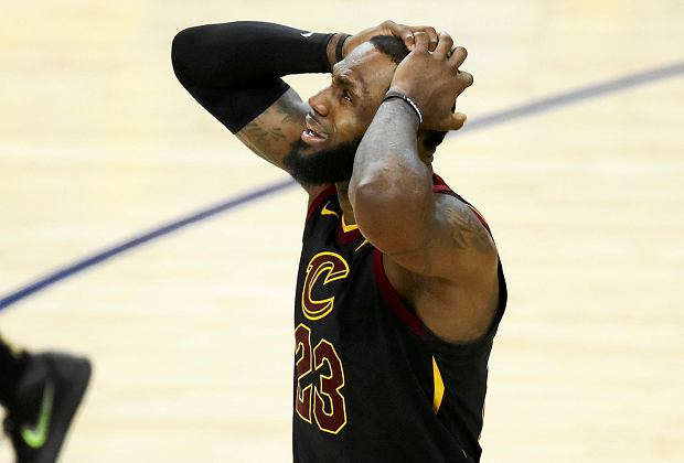 Cleveland Cavaliers forward LeBron James reacts to a call during the second half of Game 1 of basketball's NBA Finals between the Golden State Warriors and the Cavaliers in Oakland, Calif., Thursday, May 31, 2018. (AP Photo/Ben Margot)