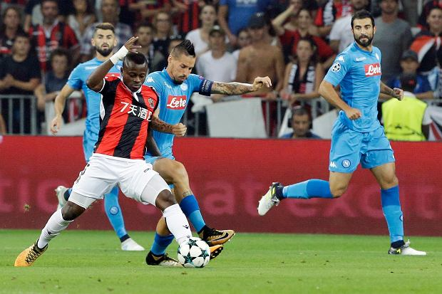 Nice's Jean Michael Seri, left, and Napoli's Marek Hamsikvie for the ball during a Champions League playoff round, second leg soccer match between Nice and Napoli in Nice, France, Tuesday, Aug. 22, 2017. (AP Photo/Claude Paris)
