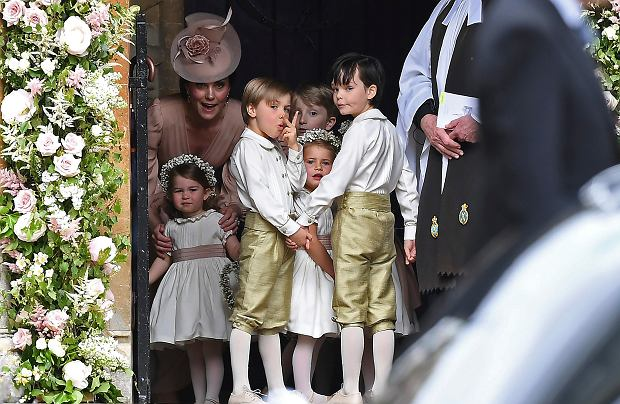 Britain's Kate, Duchess of Cambridge, left, stands with her daughter Princess Charlotte, and the other bridesmaids and pageboys prior to the wedding of Pippa Middleton and James Matthews, at St Mark,Äos Church in Englefield, England, Saturday, May 20, 2017. Middleton, the younger sister of Kate, Duchess of Cambridge is to marry hedge fund manager James Matthews in a ceremony Saturday where her niece and nephew Prince George and Princess Charlotte are in the wedding party, along with sister Kate and princes Harry and William. (Justin Tallis/Pool Photo via AP)