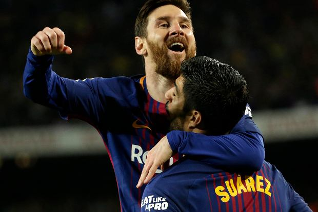 Barcelona's Lionel Messi, top, celebrates with Barcelona's Luis Suarez after scoring his side's second goal during a Spanish La Liga soccer match between Barcelona and Real Madrid, dubbed 'El Clasico', at the Camp Nou stadium in Barcelona, Spain, Sunday, May 6, 2018. (AP Photo/Emilio Morenatti) SLOWA KLUCZOWE: XLALIGAX