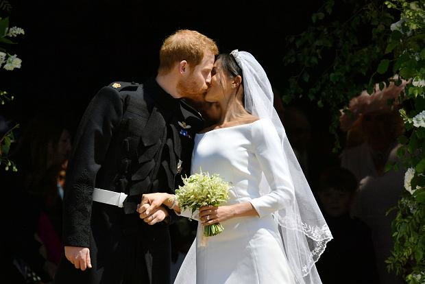 Prince Harry and Meghan Markle leave after their wedding ceremony at St. George's Chapel in Windsor Castle in Windsor, near London, England, Saturday, May 19, 2018. (Ben Birchhall/pool photo via AP)