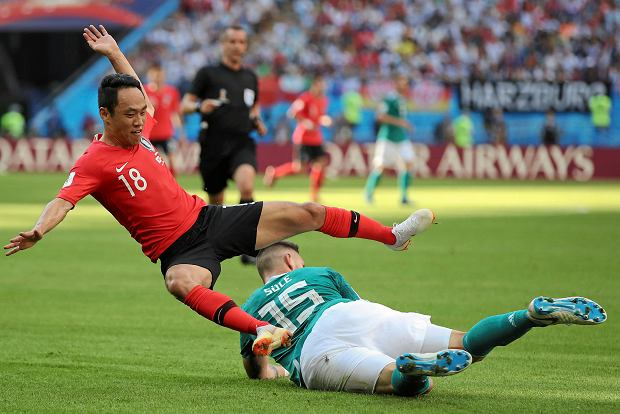 South Korea's Moon Seon-min, left, and Germany's Niklas Suele fight for the ball during the group F match between South Korea and Germany, at the 2018 soccer World Cup in the Kazan Arena in Kazan, Russia, Wednesday, June 27, 2018. (AP Photo/Thanassis Stavrakis) SLOWA KLUCZOWE: WC2018KOR;WC2018DEU