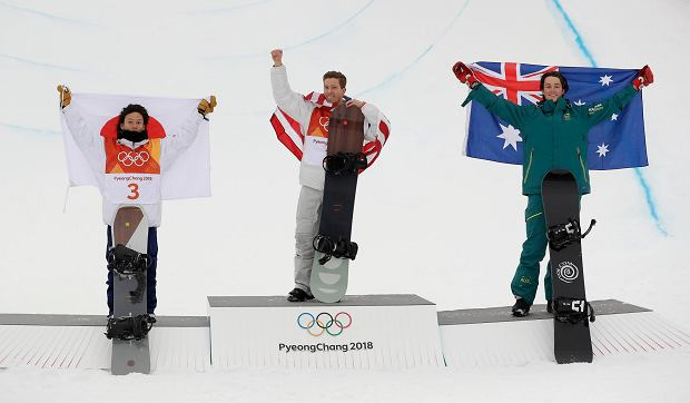 From left; Silver medal winner Ayumu Hirano, of Japan, gold medal winner Shaun White, of the United States, and bronze medal winner Scotty James, of Australia, celebrate after the men's halfpipe finals at Phoenix Snow Park at the 2018 Winter Olympics in Pyeongchang, South Korea, Wednesday, Feb. 14, 2018. (AP Photo/Gregory Bull) SLOWA KLUCZOWE: 2018 Pyeongchang Olympic Games;Winter Olympic games;Sports;Events;XXIII Olympiad