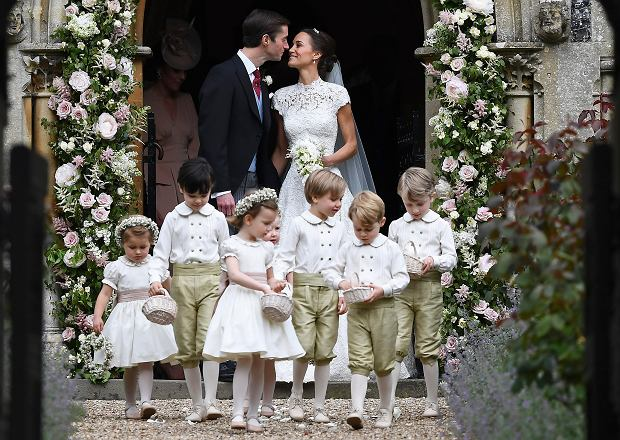 Pippa Middleton, background right, kisses James Matthews after their wedding at St Mark