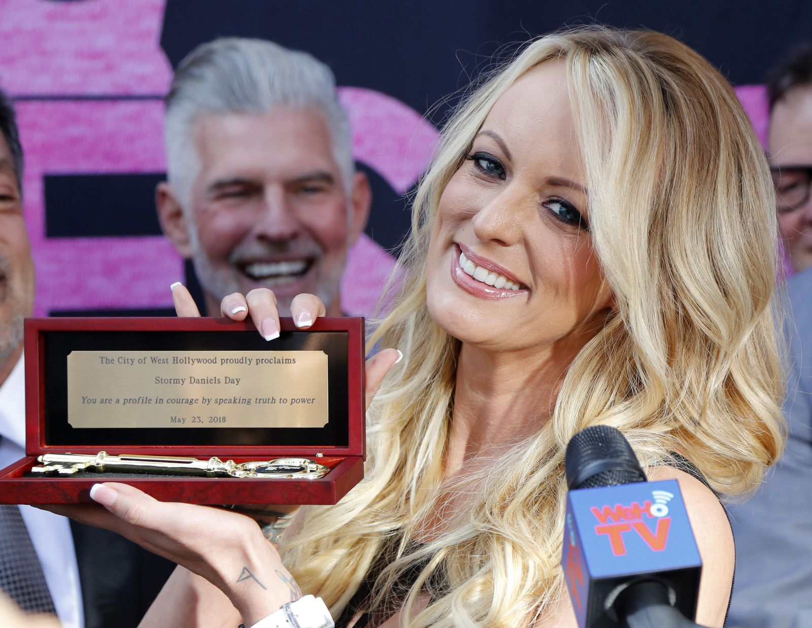 Stormy Daniels shows the Key during a ceremony for her receiving a City Proclamation and Key to the City on Wednesday, May 23, 2018 in West Hollywood, Calif. (AP Photo/Ringo H.W. Chiu)