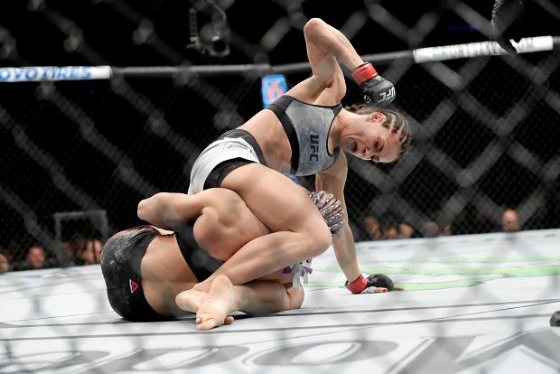 Karolina Kowalkiewicz, above, of Poland punches Felice Herrig during the first round of a women's strawweight mixed martial arts bout at UFC 223, Saturday, April 7, 2018, in New York. Kowalkiewicz won the fight. (AP Photo/Frank Franklin II)