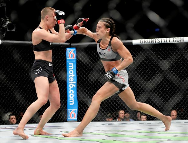 Rose Namajunas deflects a punch by Poland's Joanna Jedrzejczyk, right, during the fourth round of a women's strawweight title bout at UFC 223, early Sunday, April 8, 2018, in New York. Namajunas won the fight. (AP Photo/Frank Franklin II)