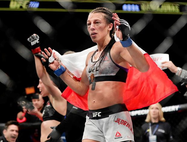 Poland's Joanna Jedrzejczyk, front, reacts after losing to Rose Namajunas in a women's strawweight title bout at UFC 223 early Sunday, April 8, 2018, in New York. Namajunas won the fight. (AP Photo/Frank Franklin II)