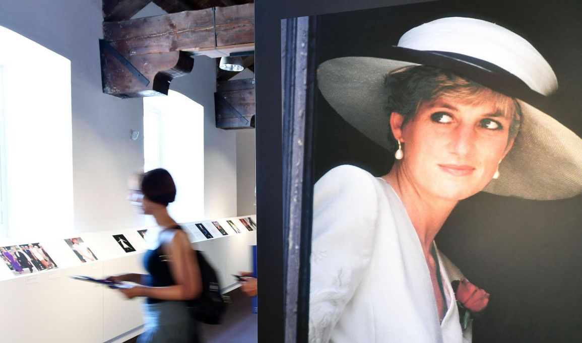 =Visitors attend the preview of the exhibition Lady Diana a Free Spirit' at the Reggio di Venaria, Turin, northern Italy, Friday, July 7, 2017. The exhibition, which remembers Princess Diana twenty years after her death in a car accident in Paris, runs from July 8 to Aug. 28, 2017. .(Alessandro Di Marco/ANSA via AP)
