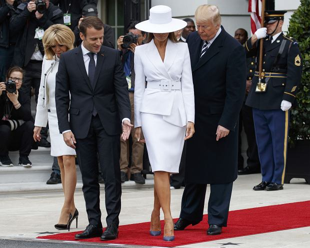 )From right, President Donald Trump, first lady Melania Trump, French President Emmanuel Macron and his wife Brigitte Macron, take their positions for a photograph during a State Arrival Ceremony on the South Lawn of the White House in Washington, Tuesday, April 24, 2018. (AP Photo/Carolyn Kaster)