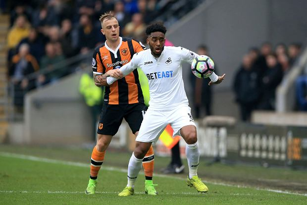 Hull City's Kamil Grosicki, left, and Swansea City's Leroy Fer in action during their English Premier League soccer match at the KCOM Stadium in Hull, England, Saturday March 11, 2017. (Nigel French/PA via AP)