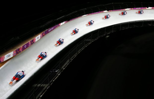 In this image made with a multiple exposure, Yun Sung-bin of South Korea speeds down the track during the mens skeleton final competition at the 2014 Winter Olympics, Saturday, Feb. 15, 2014, in Krasnaya Polyana, Russia.  (AP Photo/Felipe Dana)