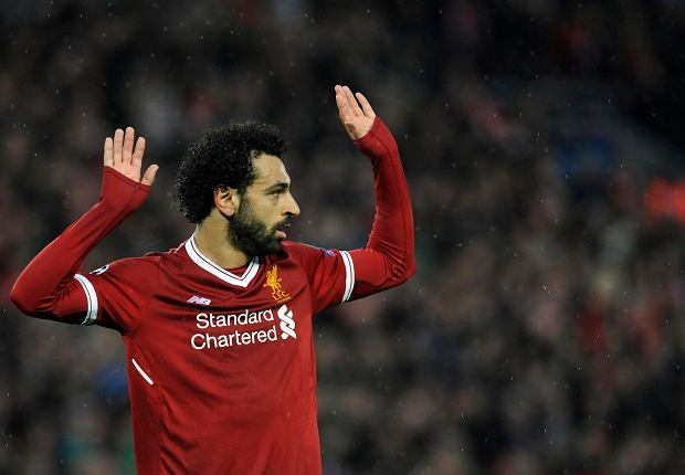 Liverpool's Mohamed Salah celebrates after scoring his side's second goal during the Champions League semifinal, first leg, soccer match between Liverpool and Roma at Anfield Stadium, Liverpool, England, Tuesday, April 24, 2018. (AP Photo/Rui Vieira) SLOWA KLUCZOWE: XCHAMPIONSLEAGUEX