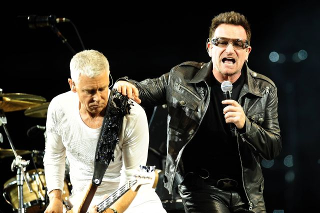 Bono, right, and Adam Clayton of Irish band U2 perform during their first concert of the new European tour after Bono underwent back surgery following an injury during training, in Turin, Italy, Friday, Aug. 6, 2010. After the European dates, the band will then head to the United States, Australia and New Zealand for a series of shows. (AP Photo/Massimo Pinca)