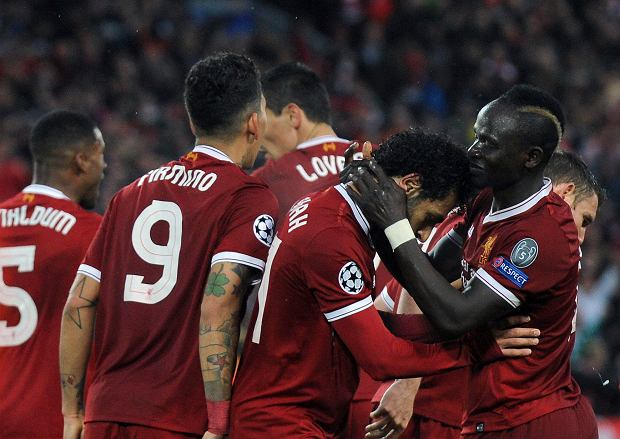 Liverpool's Mohamed Salah, second right, celebrates with teammates after scoring his side's second goal during the Champions League semifinal, first leg, soccer match between Liverpool and Roma at Anfield Stadium, Liverpool, England, Tuesday, April 24, 2018. (AP Photo/Rui Vieira) SLOWA KLUCZOWE: XCHAMPIONSLEAGUEX