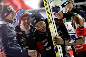 Bronze medal winners team Poland with Piotr Zyla, Stefan Hula, Kamil Stoch and Dawid Kubacki celebrate after the team competition round at the Ski Flying World Championships in Oberstdorf, Germany, Sunday, Jan. 21, 2018. (AP Photo/Matthias Schrader)