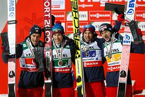 Bronze medal winners team Poland with Piotr Zyla, from left, Stefan Hula, Kamil Stoch and Dawid Kubacki celebrate after the Ski Flying World Championships in Oberstdorf, Germany, Sunday, Jan. 21, 2018. (AP Photo/Matthias Schrader)