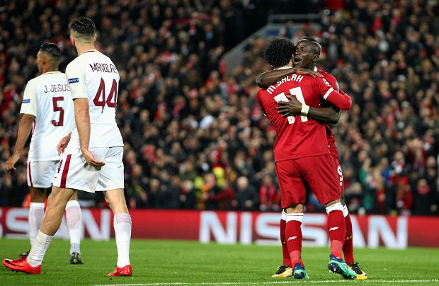 Liverpool's Sadio Mane, right, celebrates with Mohamed Salah after scoring his side's third goal during the Champions League semifinal, first leg, soccer match between Liverpool and AS Roma at Anfield Stadium, Liverpool, England, Tuesday, April 24, 2018. (AP Photo/Dave Thompson) SLOWA KLUCZOWE: XCHAMPIONSLEAGUEX