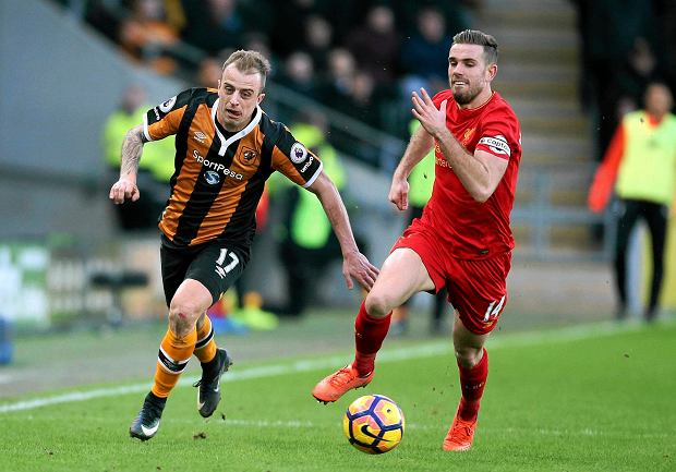 Hull City's Kamil Grosicki, left, and Liverpool's Jordan Henderson  battle for the ball during the English Premier League soccer match at the KCOM Stadium, Hull, England, Saturday Feb. 4, 2017. (Danny Lawson/PA via AP)