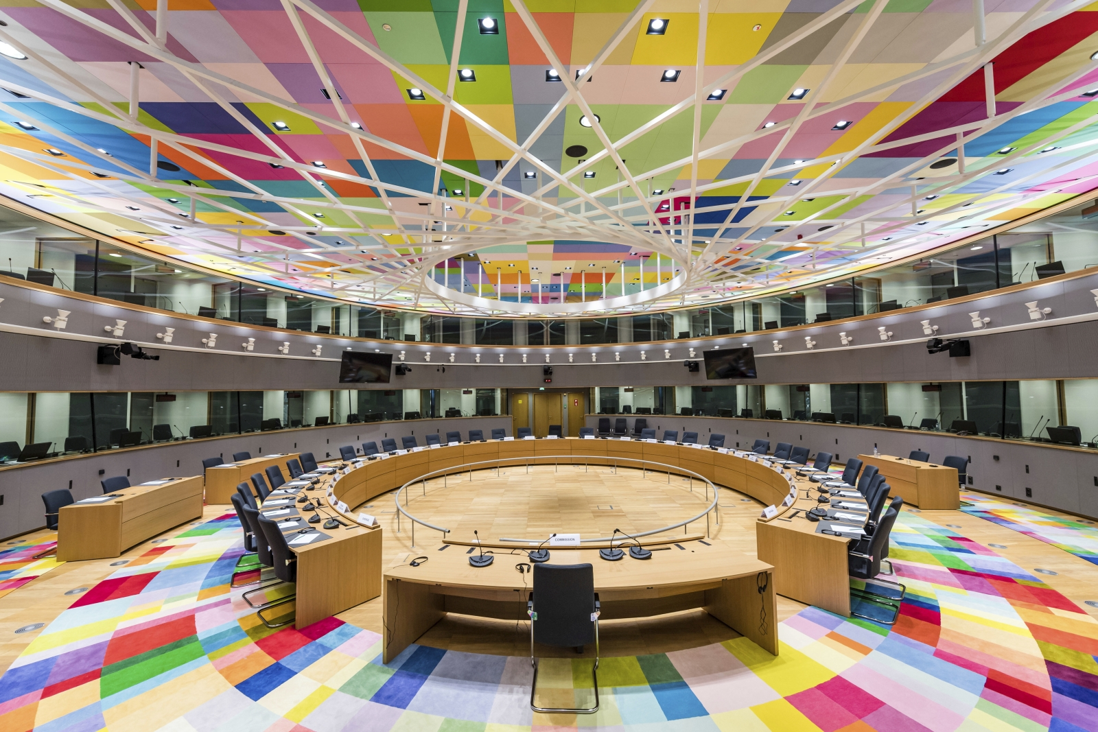 File - In this Dec. 9, 2017 file photo, colourful carpets decorate the main meeting room at the Europa building in Brussels. The European Union is making a belated change in venue of their two-day summit opening on Thursday, Oct. 18, 2017 because of toxic fumes in the recently opened Europa building. Instead of the egg-shaped building, the 28 EU leaders will now meet at the adjacent Justus Lipsius building, where they have a long tradition of hosting summits before the switch early this year. (AP Photo/Geert Vanden Wijngaert, File)