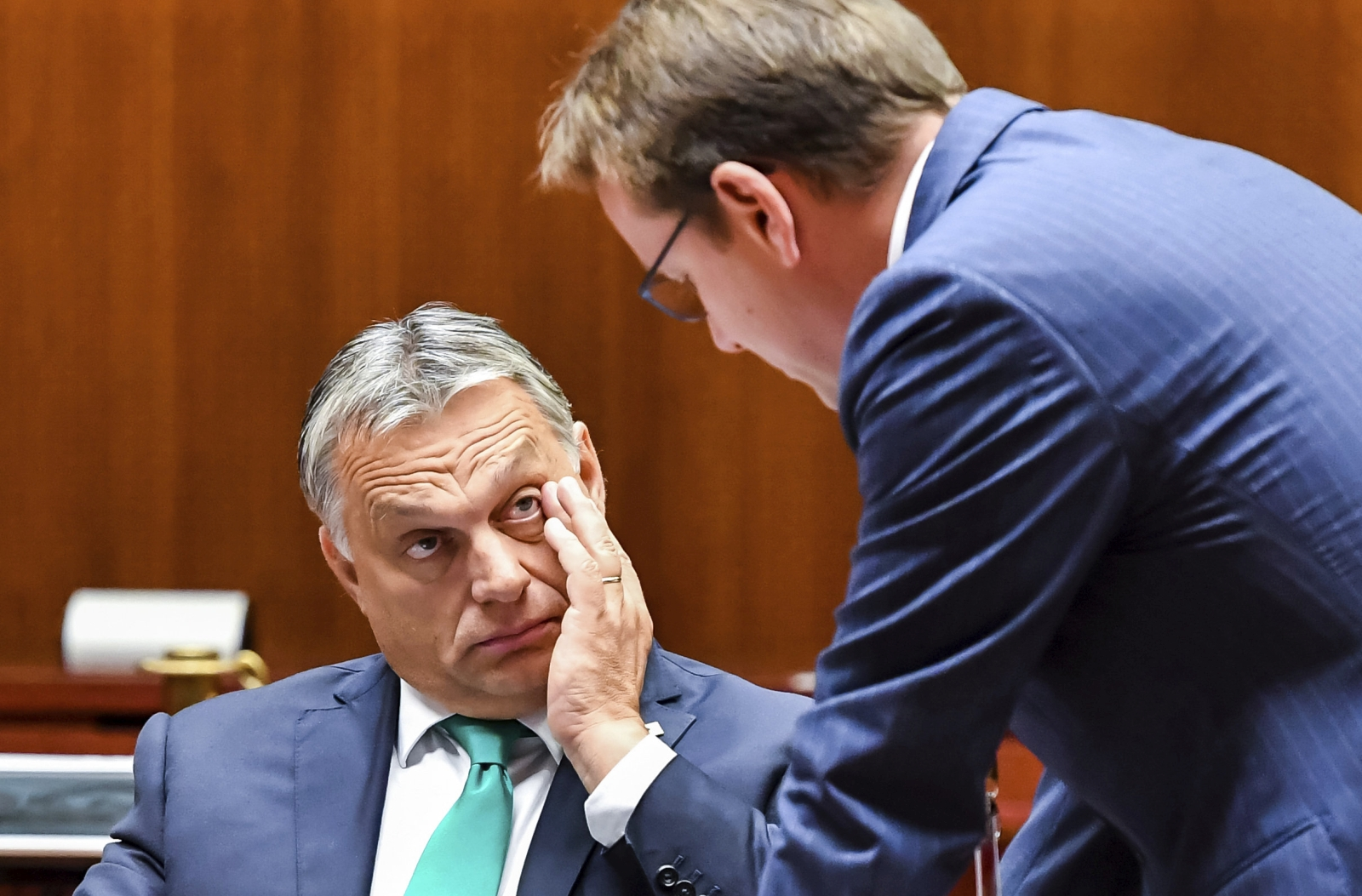 Hungarian Prime Minister Viktor Orban, left, waits for the start of a round table meeting at an EU summit in Brussels on Friday, Oct. 20, 2017. European Union leaders gathered Friday to weigh progress in negotiations on Britain's departure from their club as they look for new ways to speed up the painfully slow moving process. (AP Photo/Geert Vanden Wijngaert)