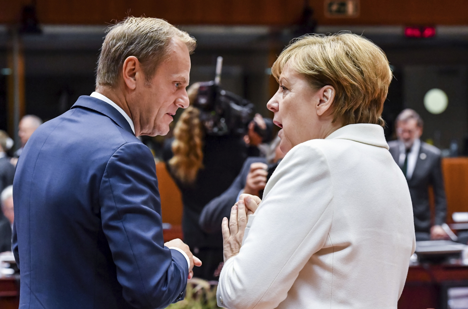 German Chancellor Angela Merkel, right, speaks with European Council President Donald Tusk during a round table meeting at an EU summit in Brussels on Friday, Oct. 20, 2017. European Union leaders gathered Friday to weigh progress in negotiations on Britain's departure from their club as they look for new ways to speed up the painfully slow moving process. (AP Photo/Geert Vanden Wijngaert)