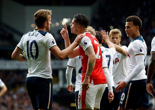 Arsenal's Granit Xhaka, center, shouts at Tottenham Hotspur's Harry Kane, left, after he went down for a penalty during the English Premier League soccer match between Tottenham Hotspur and Arsenal at White Hart Lane in London, Sunday, April 30, 2017. (AP Photo/Alastair Grant)