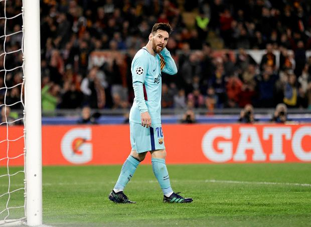 Barcelona's Lionel Messi reacts after missing a scoring chance during the Champions League quarterfinal second leg soccer match between Roma and FC Barcelona at Rome's Olympic Stadium, Tuesday, April 10, 2018. Roma won 3-0 and advances to the semifinals. (AP Photo/Andrew Medichini) SLOWA KLUCZOWE: XCHAMPIONSLEAGUEX