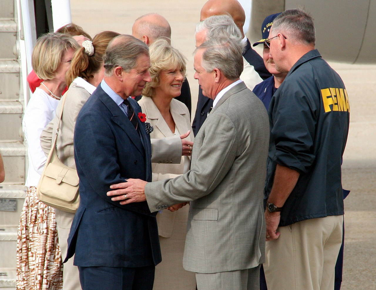 New Orleans, LA, November 4, 2005 - Prince Charles and Camilla greet FEMA officials as they arrive to tour the damages created by Hurricane Katrina in New Orleans.  Robert Kaufmann/FEMA