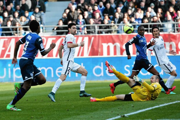 PSG's Javier Pastore, second from left, shoots past Troyes' goalkeeper Matthieu Dreyer, to score during his League One soccer match against Troyes, in Troyes, France, Sunday, March 13, 2016. (AP Photo/Thibault Camus)