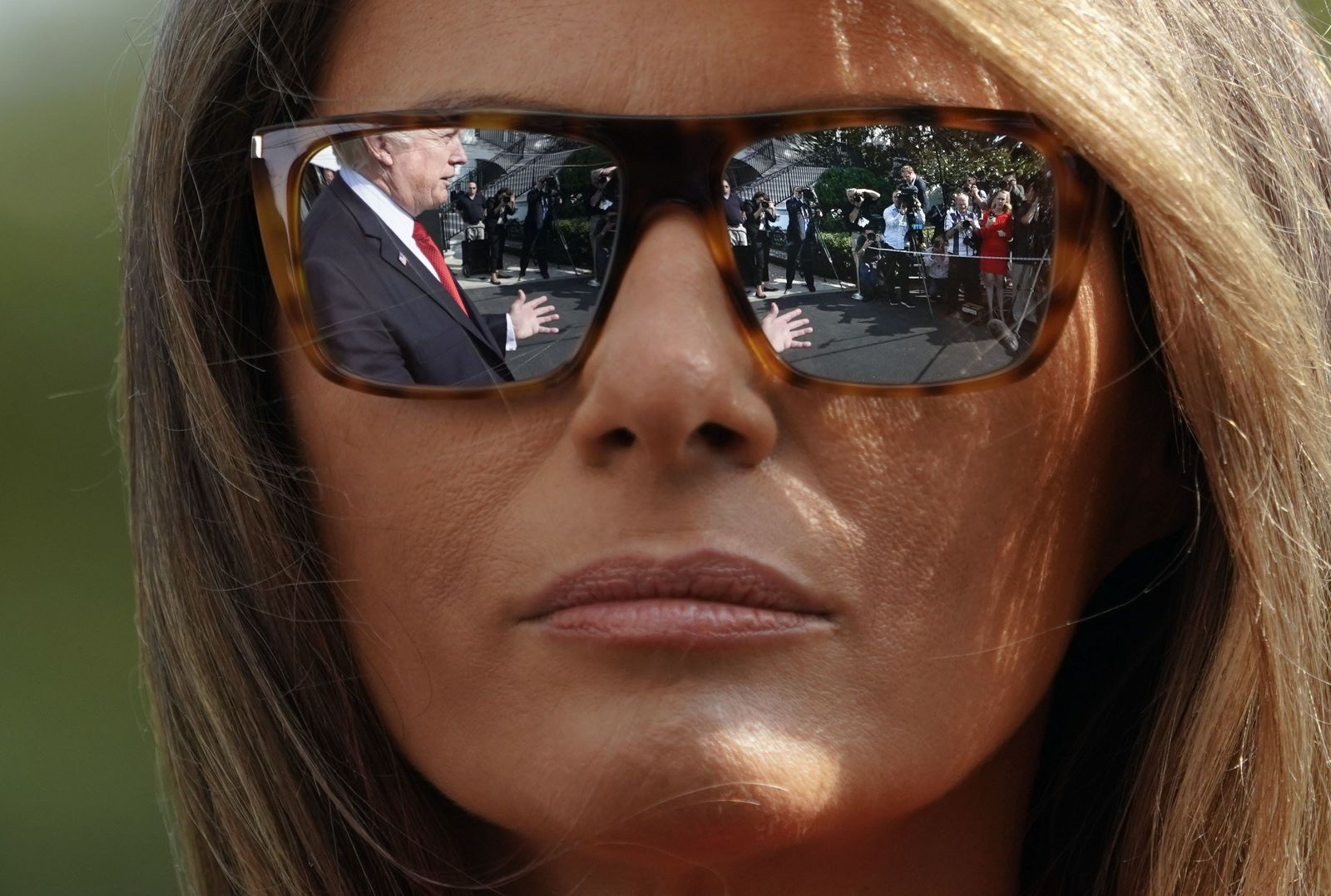 President Donald Trump and first lady Melania Trump walk across the South Lawn of the White House in Washington during their arrival on Marine One helicopter, Sunday, Sept. 10, 2017. (AP Photo/Pablo Martinez Monsivais)