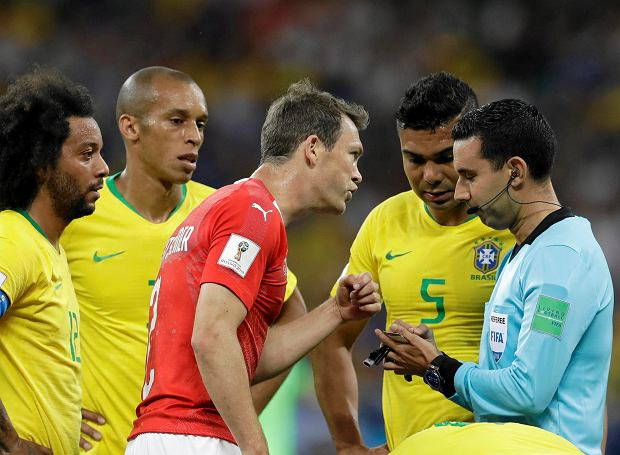 Switzerland's Stephan Lichtsteiner, centre , reacts after Mexican referee Cesar Arturo Ramos showed the yellow card to him during the group E match between Brazil and Switzerland at the 2018 soccer World Cup in the Rostov Arena in Rostov-on-Don, Russia, Sunday, June 17, 2018. (AP Photo/Themba Hadebe) SLOWA KLUCZOWE: WC2018BRA;WC2018CHE