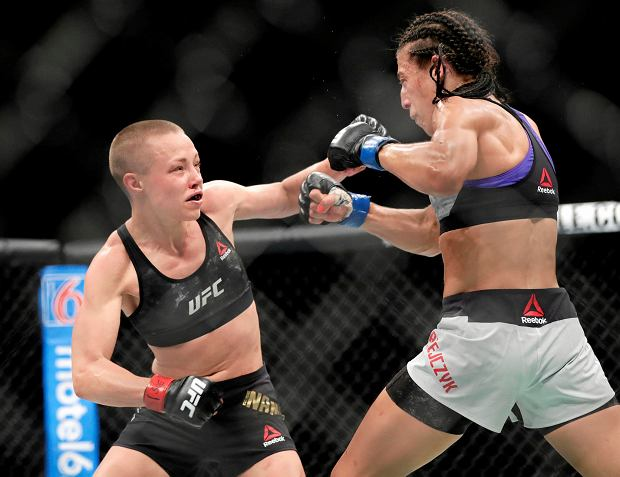 Rose Namajunas, left, punches Poland's Joanna Jedrzejczyk during the fifth round of a women's strawweight title bout at UFC 223 early Sunday, April 8, 2018, in New York. Namajunas won the bout. (AP Photo/Frank Franklin II)