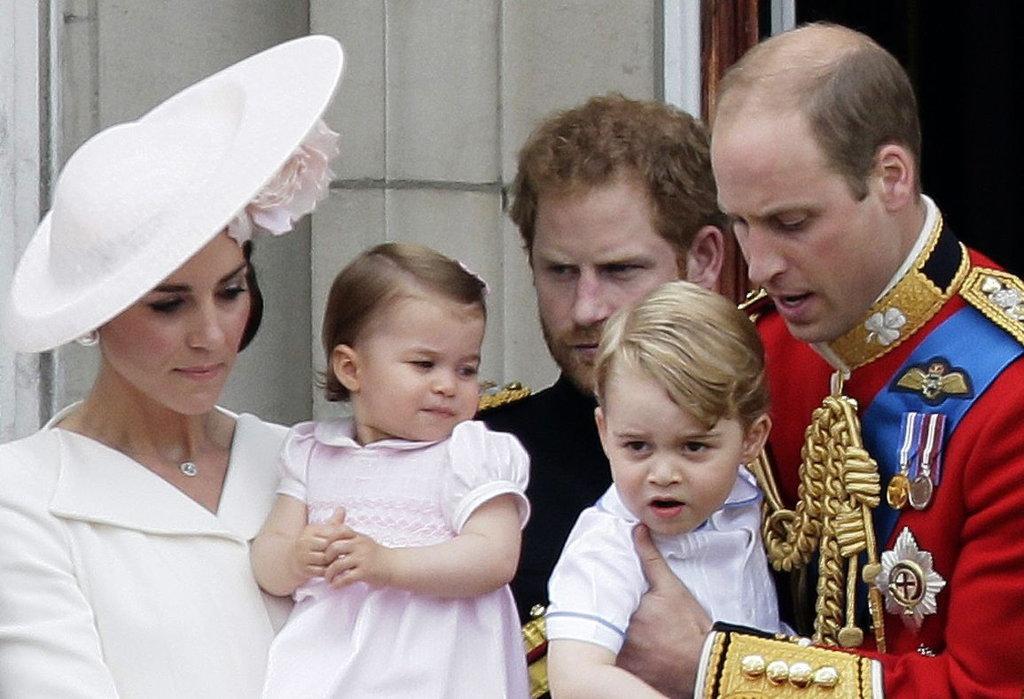 FILE - In this Saturday, June 11, 2016 file photo, Britains Prince William holding Prince George, right and Kate, Duchess of Cambridge holding Princess Charlotte, left, on the balcony during the Trooping The Colour parade at Buckingham Palace, in London. Kensington Palace says in a statement Monday, July 3, 2017, the Duke and Duchess of Cambridge will take Prince George and Princess Charlotte along when they tour Germany and Poland.  (AP Photo/Tim Ireland, File)