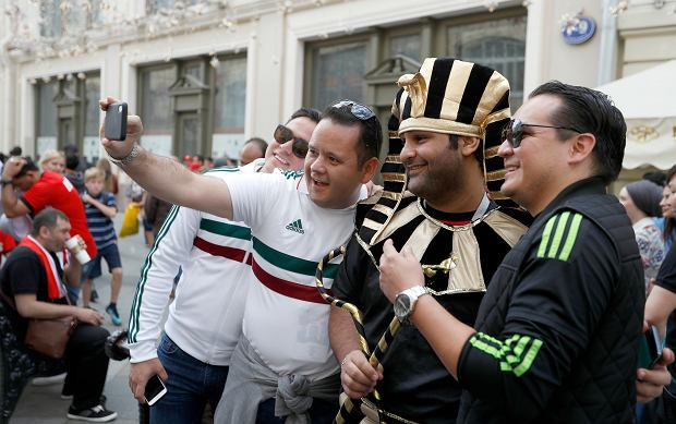 An Egyptian soccer fan wearing pharaoh outfit poses with other supporters on the eve of the opener of the 2018 soccer World Cup in downtown Moscow, Russia, Wednesday, June 13, 2018. (AP Photo/Darko Bandic)