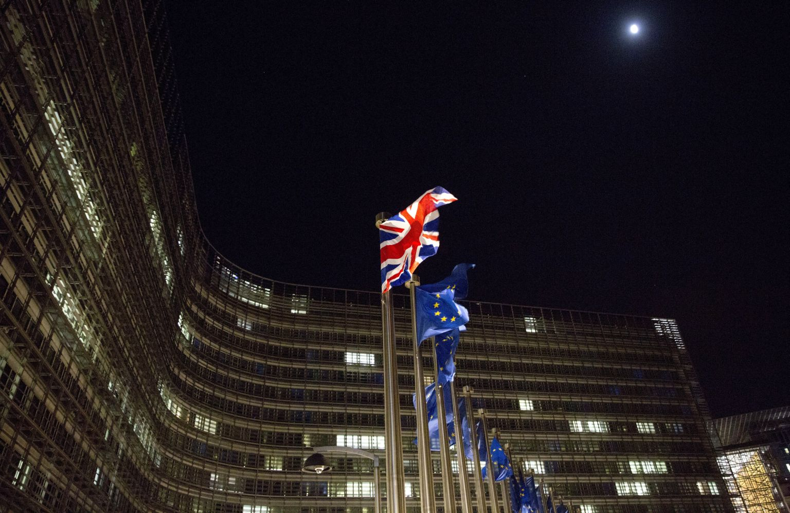 7The British and EU flags flap in the wind outside EU headquarters in Brussels on Friday, Dec. 8, 2017. British Prime Minister Theresa May, met with European Commission President Jean-Claude Juncker early Friday morning following crucial overnight talks on the issue of the Irish border. (AP Photo/Virginia Mayo)