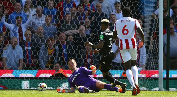 Crystal Palace's Patrick van Aanholt scores his side's second goal of the game, during the English Premier League soccer match between Stoke City and Crystal Palace, at the bet365 Stadium, in Stoke, England, Saturday May 5, 2018. (Dave Thompson/PA via AP) SLOWA KLUCZOWE: soccer;football