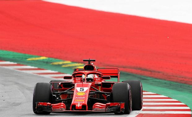 Ferrari driver Sebastian Vettel of Germany takes a curve during the third free practice session for the Austrian Formula One Grand Prix at the Red Bull Ring racetrack in Spielberg, southern Austria, Saturday June 30, 2018. The race will be held on Sunday. (AP Photo/Ronald Zak) SLOWA KLUCZOWE: f1autoz18
