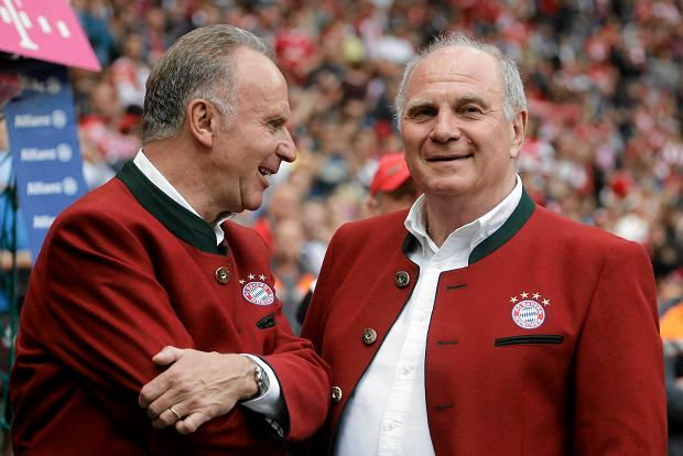 Bayern's CEO Karl-Heinz Rummenigge, left, and president Uli Hoeness wait for the start of the German first division Bundesliga soccer match between FC Bayern Munich and SC Freiburg at the Allianz Arena stadium in Munich, Germany, Saturday, May 20, 2017. (AP Photo/Matthias Schrader)