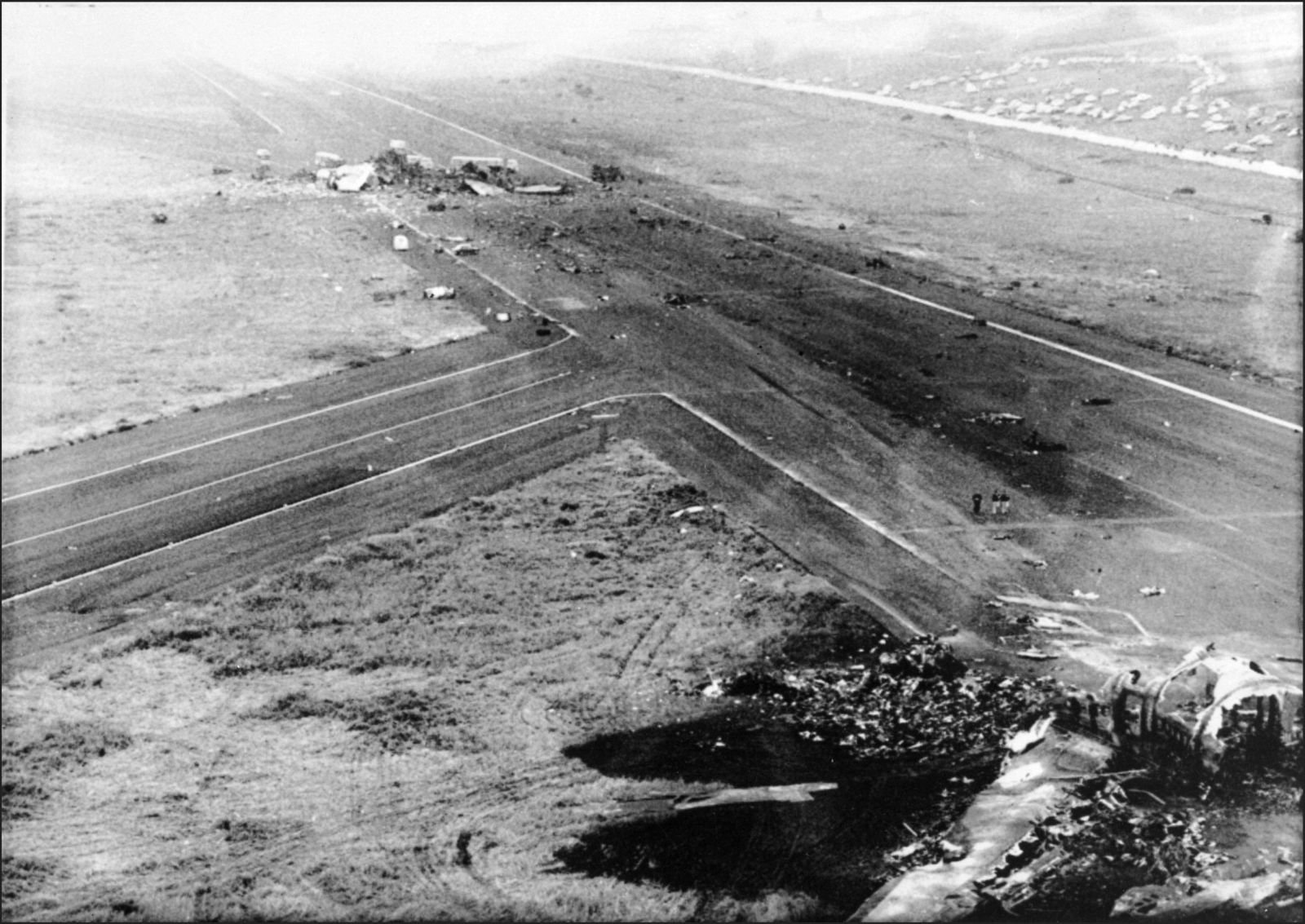 PHOTO: EAST NEWS/AFP Aerial view taken 28 March 1977 of a KLM Jumbo Jet and a Boeing 747 remains that collided 27 March above Santa Cruz De Tenerife airport killing 580 passengers and crew members, many people beeing injured.