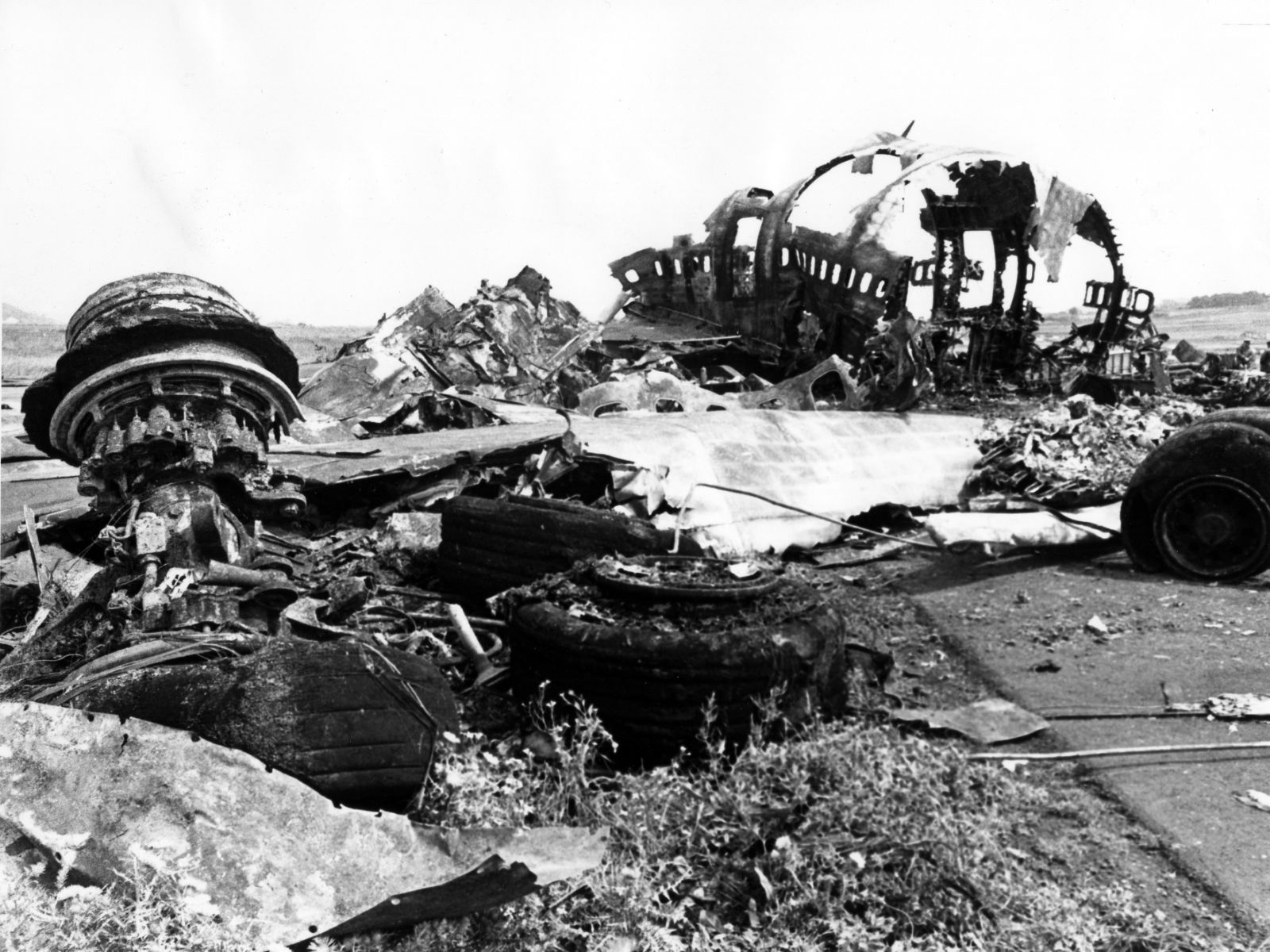The wreckage of the Pan American World Airways 747 aircraft and KLM Boeing 747 jumbo jet lie at the airport in Santa Cruz de Tenerife, Canary Islands, Spain, Monday, March 28, 1977. 583 people died yesterday, after the two planes collided in foggy weather. (AP Photo)