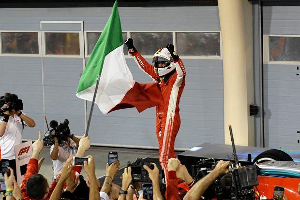 Ferrari driver Sebastian Vettel of Germany celebrates after winning the Bahrain Formula One Grand Prix, at the Formula One Bahrain International Circuit in Sakhir, Bahrain, Sunday, April 8, 2018. (AP Photo/Luca Bruno) SLOWA KLUCZOWE: f1autoz18