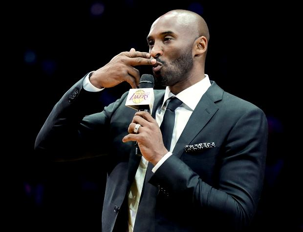 Former Los Angeles Laker Kobe Bryant speaks during a halftime ceremony retiring both of his jersey's during an NBA basketball game between the Los Angeles Lakers and the Golden State Warriors in Los Angeles, Monday, Dec. 18, 2017. (AP Photo/Chris Carlson)