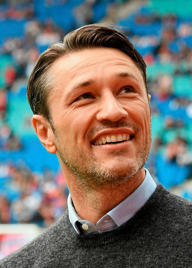FILE - In this Sept. 23, 2017 file photo, Frankfurt's head coach Niko Kovac smiles prior to the German first division Bundesliga soccer match between RB Leipzig and Eintracht Frankfurt in Leipzig, Germany. (AP Photo/Jens Meyer, file)
