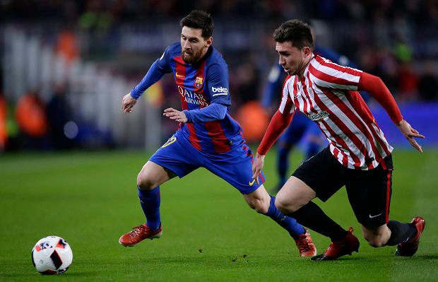 FC Barcelona's Lionel Messi, left, duels for the ball against Athletic Bilbao's Aymeric Laporte during Copa del Rey, 16 round, second leg, between FC Barcelona and Athletic Bilbao at the Camp Nou in Barcelona, Spain, Wednesday, Jan. 11, 2017. (AP Photo/Manu Fernandez)