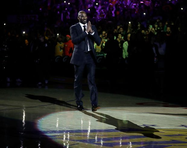 Former Los Angeles Laker Kobe Bryant arrives for a halftime ceremony, retiring both of his jersey's during an NBA basketball game between the Los Angeles Lakers and the Golden State Warriors, in Los Angeles, Monday, Dec. 18, 2017. (AP Photo/Chris Carlson)